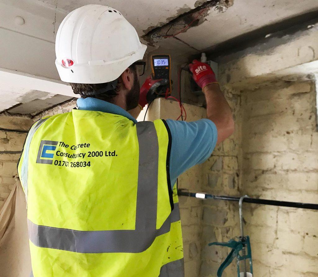 Surveyor measuring corrosion potential